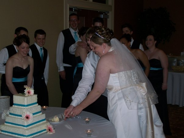 The two of us cutting our wedding cake
